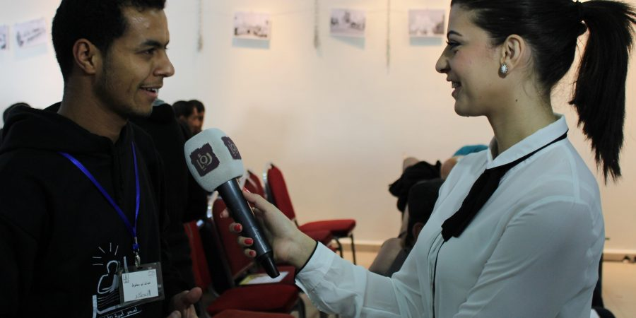 Young man in interview with journalist.
